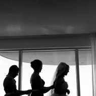 silhouette of the bridesmaids getting ready