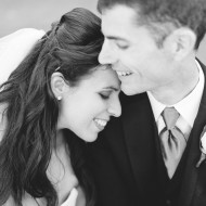 B&W image of a fun wedding couple