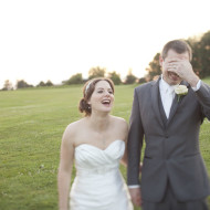 Bridal couple laughing during wedding photos