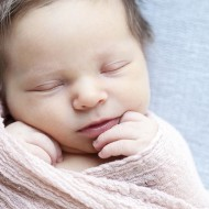 Newborn photography of a 1 week old baby girl