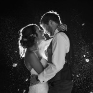 Wedding photo of a couple about to kiss