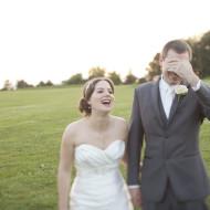 Bridal couple laughing during wedding photos