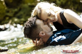 Couple laying in water