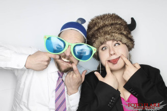 Wedding guests using our photo booth making silly faces