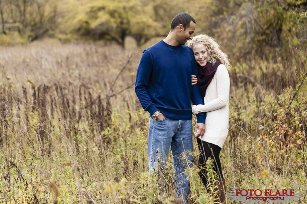 Couple standing in a field in the fall
