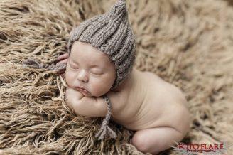 Newborn baby sleeping on furry blanket