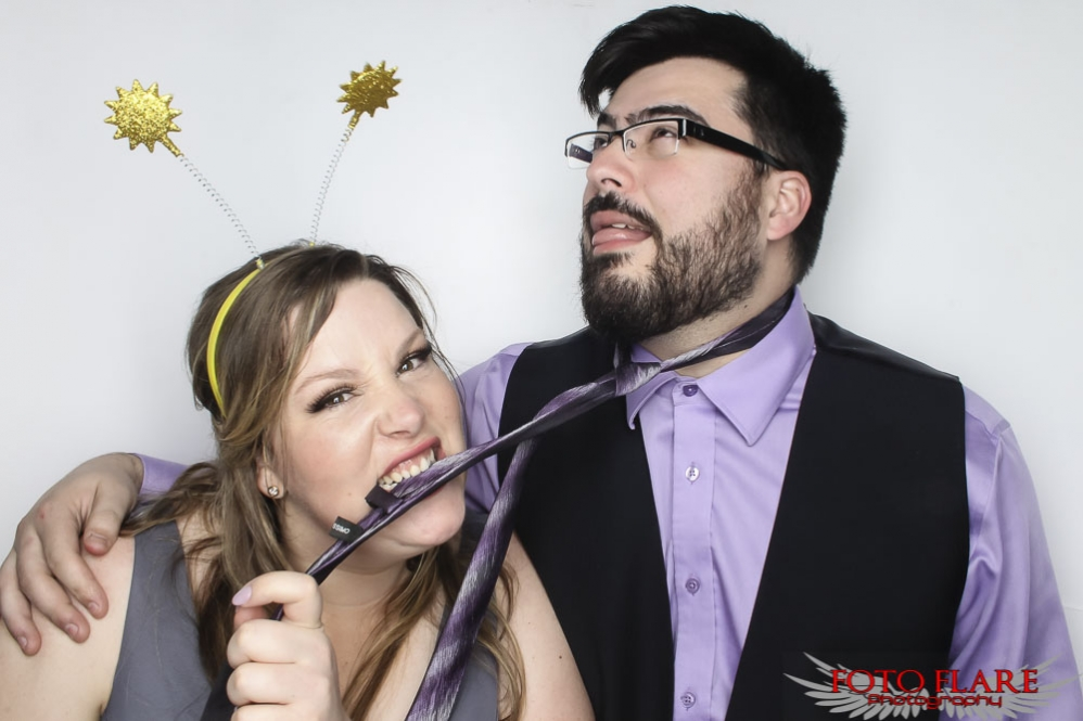 silly photo booth photos at a wedding