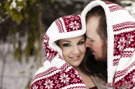 Winter engagement photos with a blanket