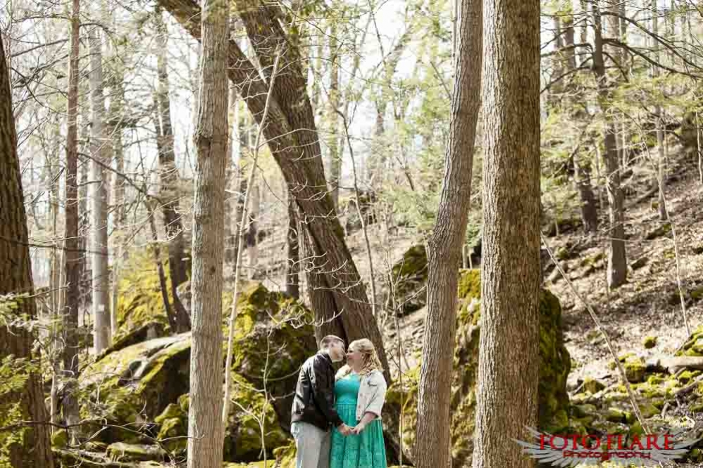 engagement photo in a forest