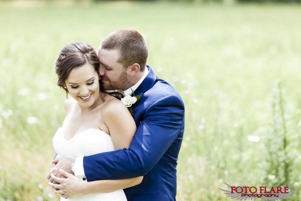 Outdoor wedding image of couple hugging