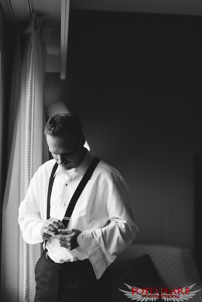 Ryan putting on suspenders