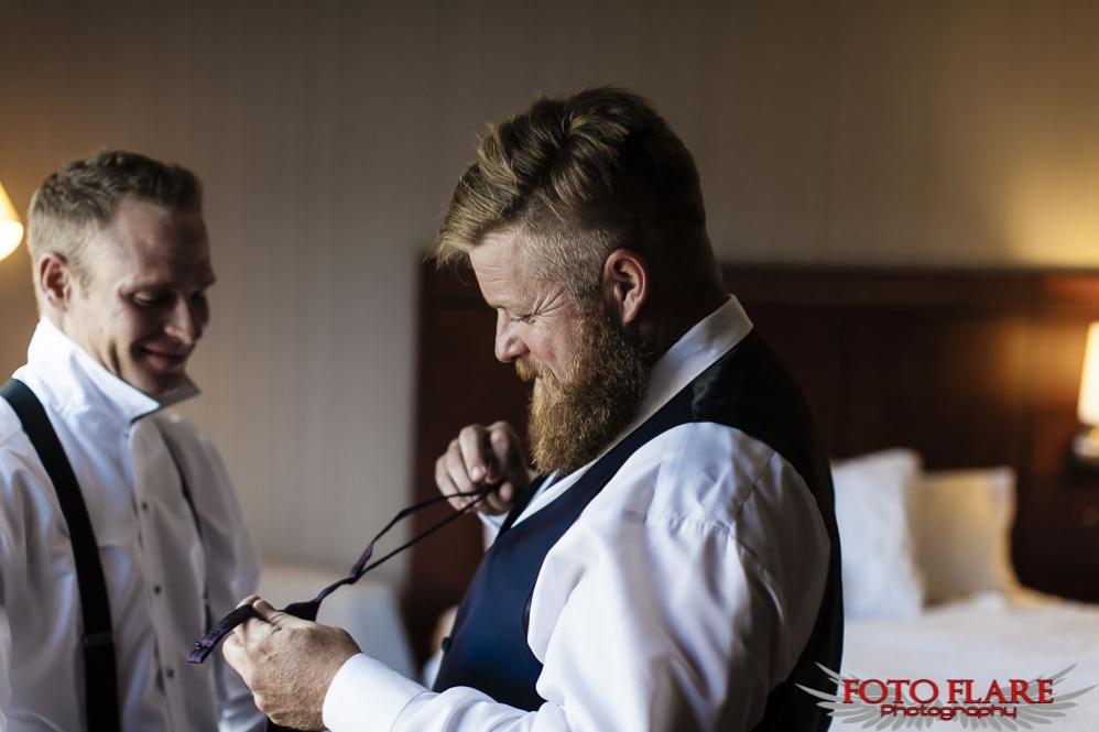 Best man helping with tie